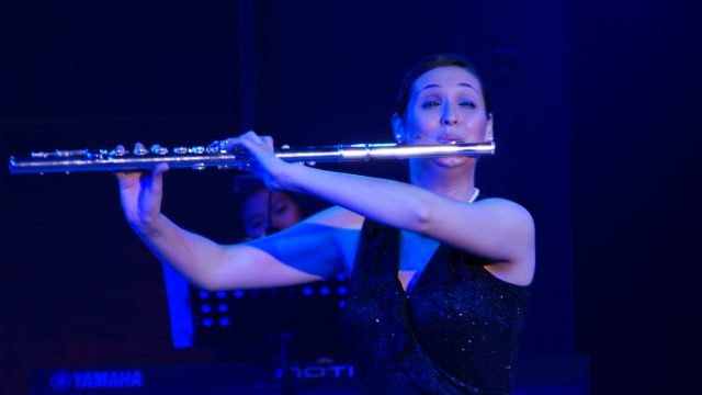 Playing her Alto flute